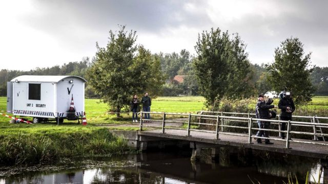 Police investigate a farm on the Buitenhuizerweg where a father and six children were living in Ruinerwold, the Netherlands, 16 October 2019