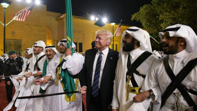 President Donald Trump joins dancers with swords at a welcome ceremony ahead of a banquet at the Murabba Palace in Riyadh on 20 May 2017