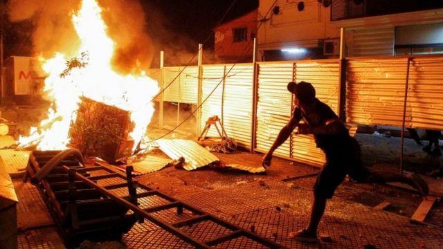 A man during the violence in Asunción.