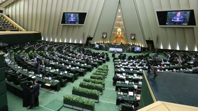 This file photo taken on March 01, 2016 shows Iranian MPs attending a parliament session in Tehran on March 1, 2016.