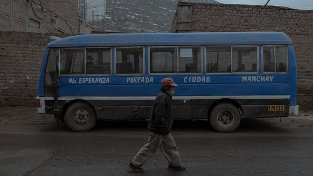 """Stop """"Nueva Esperanza"""" (marked on the bus) in Villa Maria del Triunfo, a neighborhood that suffered one of the highest rates of extreme poverty and family violence during the state of emergency imposed in Peru to stop the COVID-19 virus."""