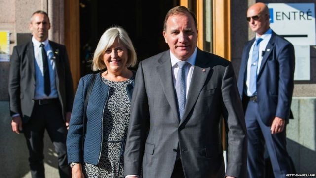 Swedish Prime Minister and leader of the Social Democratic party, Stefan Lofven and his wife Ulla Lofven leave the polling station after voting in the Swedish general elections on September 9, 2018 in Stockholm.