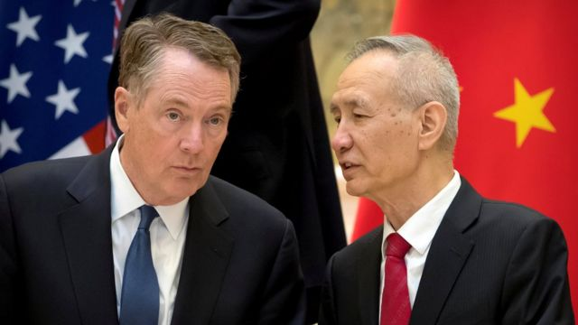 U.S. Trade Representative Robert Lighthizer, left, listens as Chinese Vice Premier Liu He talks while they line up for a group photo at the Diaoyutai State Guesthouse in Beijing, China February 15, 2019.