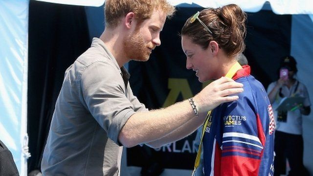 Prince Harry presents USA Invictus Team Member Elizabeth Marks with a Gold Medal