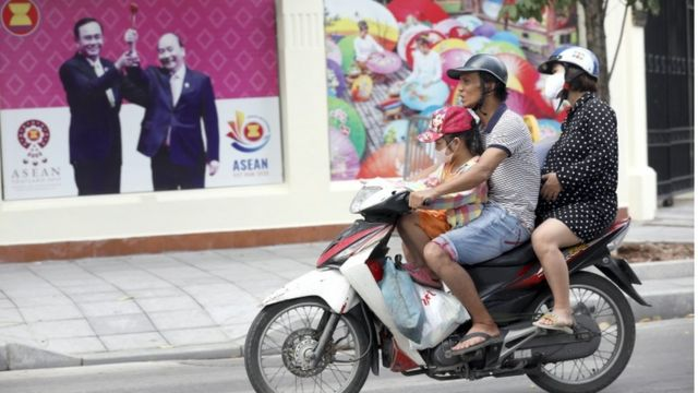Family on a motorbike in Hanoi, Vietnam