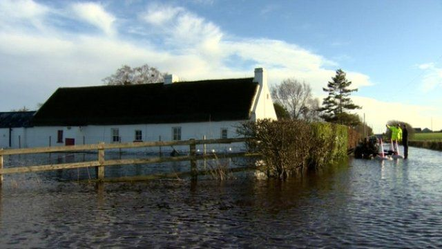 A 300-year-old listed cottage near Portadown has been surrounded by floodwater