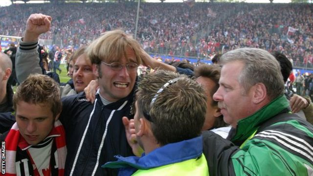 Klopp is mobbed by Mainz fans celebrating their 2004 promotion