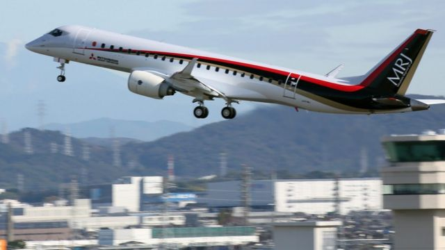 A Mitsubishi Regional Jet (MRJ) taking off for its first flight at Nagoya Airport in Toyoyama town, central Japan.