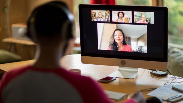 One person participates in a video conference.