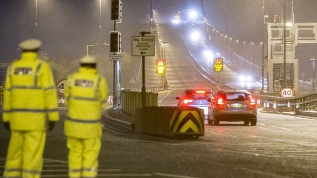 Police watch first cars cross the re-opened Forth Road Bridge