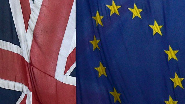 European Union and the British Union flags are seen flying outside of Europe House in London