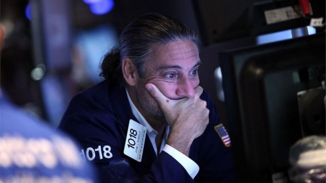 trader looking at screen