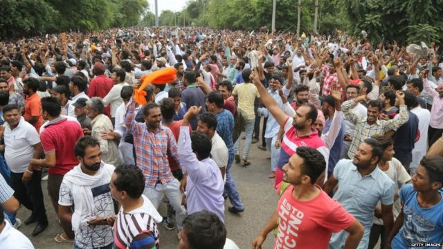 AUGUST 25: Dera followers gather to protest after the Dera chief verdict at CBI court on August 25, 2017 in Panchkula
