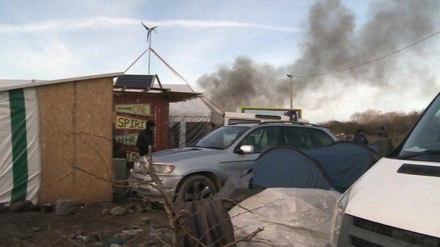 """Smoke rises over Calais """"Jungle"""""""