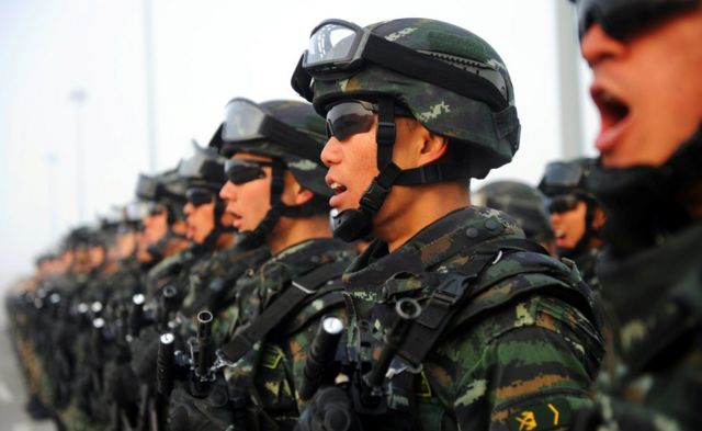 Paramilitary policemen stand in formation as they take part in an anti-terrorism oath-taking rally, in Kashgar, Xinjiang Uighur Autonomous Region, China, February 27, 2017.