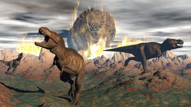 Dinosaurs running in a panic as a meteorite hits earth