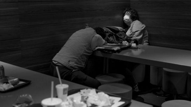 Two people asleep in McDonald's