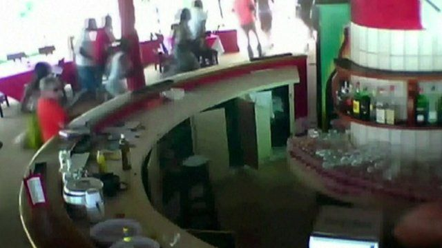 CCTV footage shows guests running from gunman in Ivory Coast attack