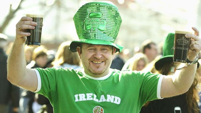 Man with two beers celebrating Saint Patrick.