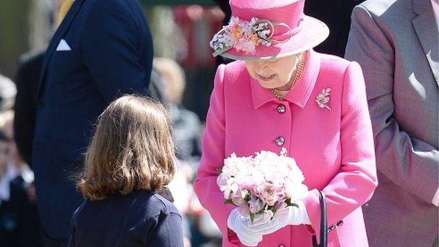 Girl giving Queen flowers