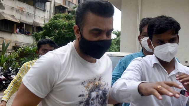 Police escort arrested Bollywood star Shilpa Shetty's husband Raj Kundra (L) for allegedly producing and broadcasting pornographic films online, in Mumbai on July 20, 2021.
