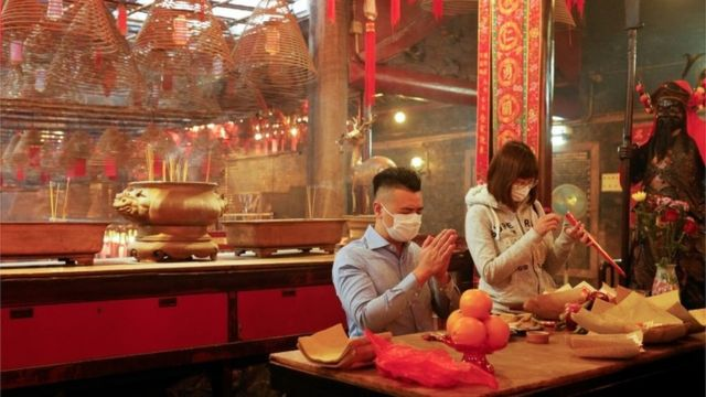 Worshippers, wearing face mask, pray ahead of the Chinese Lunar New Year, following the coronavirus disease (COVID-19) outbreak, at Man Mo Temple, in Hong Kong, China February 11, 2021.