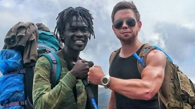 Mark Lloyd and a guide ahead of climbing Kilimanjaro