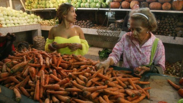 Some women shopping in a market in Maracaibo.