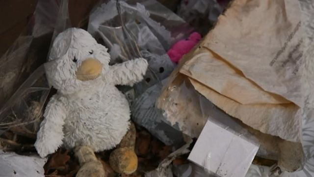 A toy with flowers left outside the house where Keegan Downer died