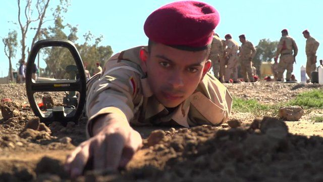 An Iraqi soldier checking for a mine in training