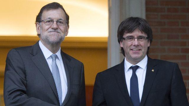 El presidente del gobierno español, Mariano Rajoy, y el presidente de Cataluña, Carles Puigdemont.