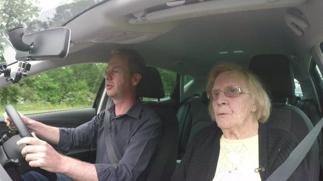 Laura Thomas and Greame Satchell in a car