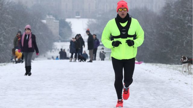 A jogger braves at Windsor Castle, Berkshire