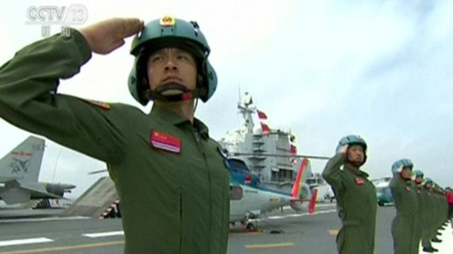 Troops salute at the Chinese naval parade
