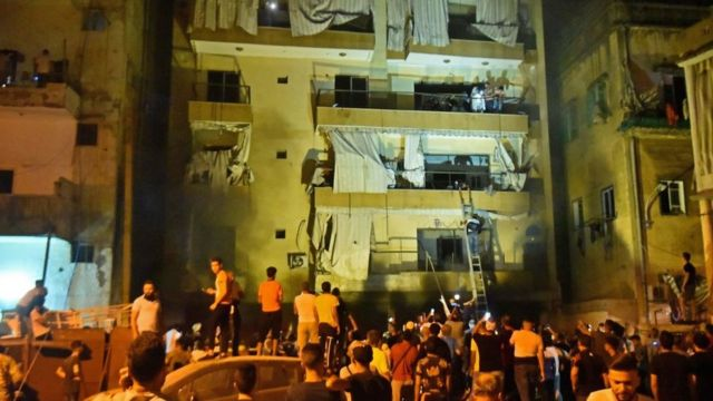 Rescuers evacuate residents after an explosion in the Tariq al-Jdide district of Lebanese capital Beirut
