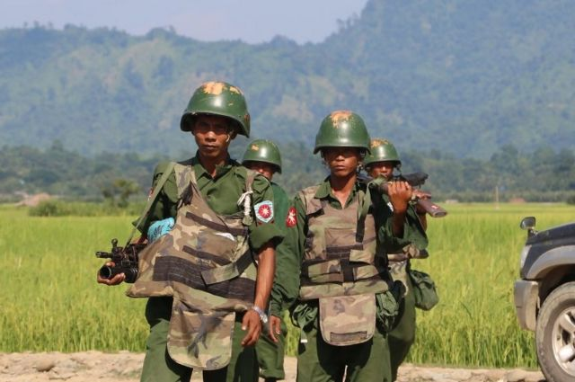 October 21, 2016, armed Myanmar soldiers patrol a village in Maungdaw