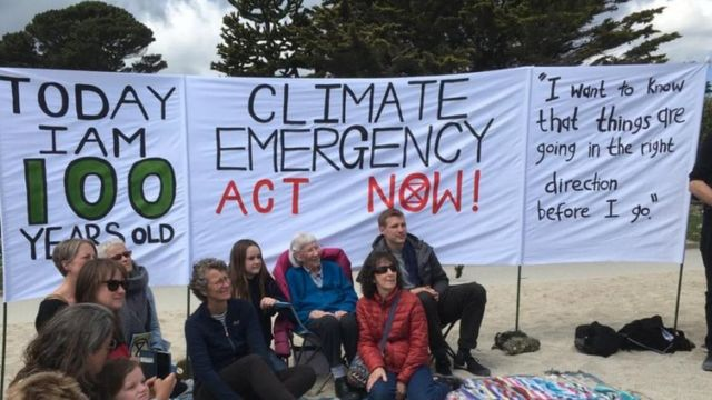 Environmental beach party protest for 100-year-old