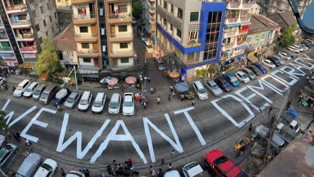 """We want democracy"" is written on the streets of Yangon, Myanmar"