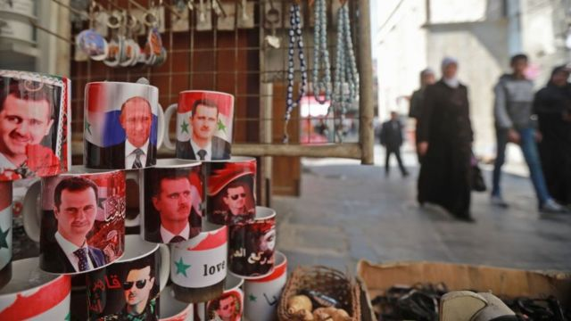 Mugs bearing the portraits of Syrian President Bashar al-Assad and Russian President Vladimir Putin are sold in the old Syrian city of Damascus on March 12, 2019. (Photo by LOUAI BESHARA / AFP) (Photo credit should read LOUAI BESHARA/AFP/Getty Images)