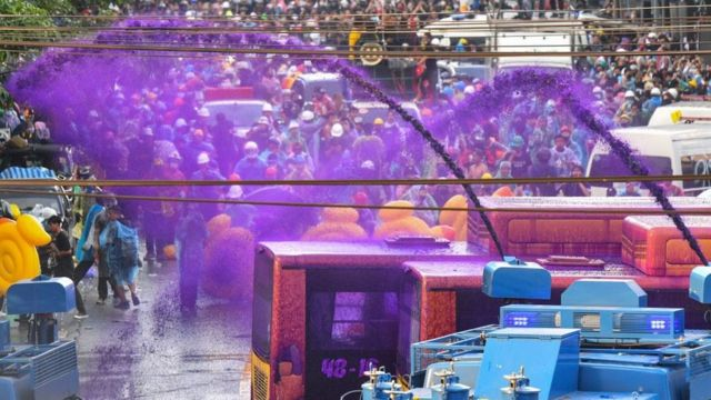 Police use a water cannon with chemical-laced water to disperse pro-democracy protesters during an anti-government rally in Bangkok on November 17, 2020