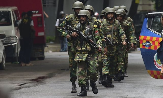 Bangladeshi army soldiers patrol a street during a rescue operation as gunmen take position in a restaurant in the Dhakas high-security diplomatic district on July 2, 2016