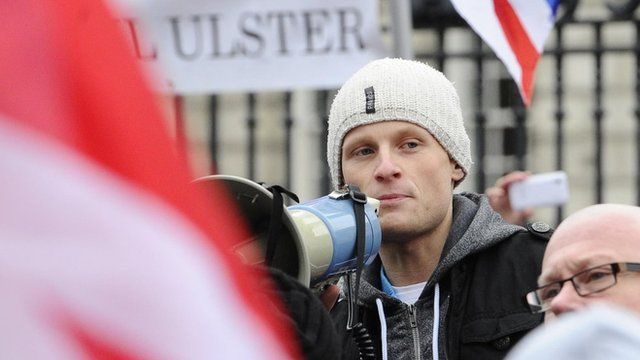 Jamie Bryson addressing protesters at a demonstration at Belfast City Hall in 2013