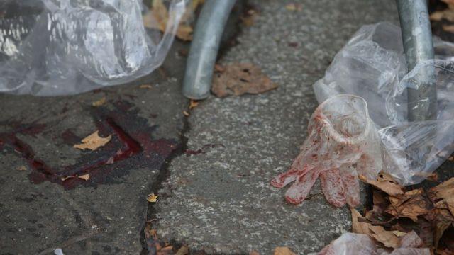 Bloody medical glove outside the Bataclan, Paris, on 14 November, 2015