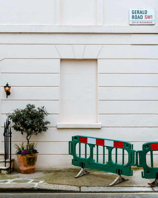 Single blocked window, with a plant and safety barrier beside it, at Gerald Road, London