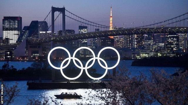 Tokyo Olympic rings lit up at night