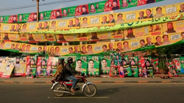 Election campaign signs along a road in Lahore (10 September 2017)