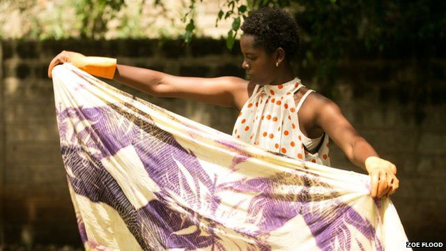 A young girl in Kenya learns about the garment industry at the Maysha Collective