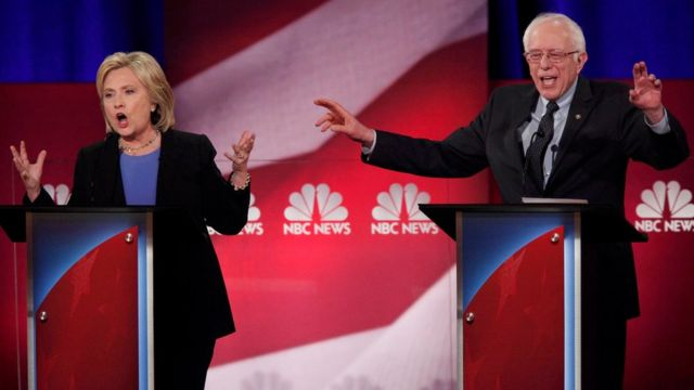 Democratic U.S. presidential candidate and former Secretary of State Hillary Clinton and rival candidate U.S. Senator Bernie Sanders speak simultaneously at the NBC News - YouTube Democratic presidential candidates debate in Charleston, South Carolina January 17, 2016