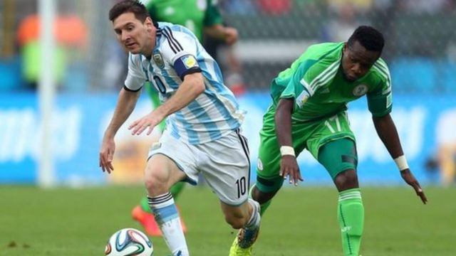 Argentina great Lionel Messi run after di ball with Nigeria Ogenyi Onazi for di 2014 World Cup inside Brazil.