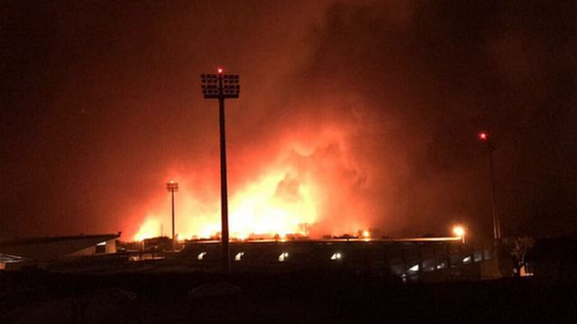 A photo showing fires approaching CD Tondela's stadium